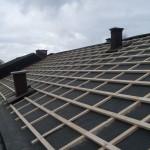 Lagt takläkt på takpapp